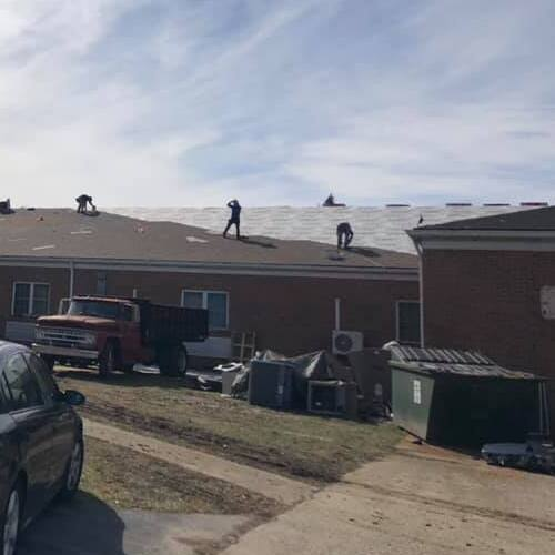 Roofers Replace Shingles